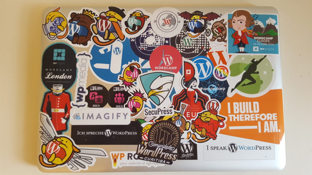 Tons of stickers on a MacBook