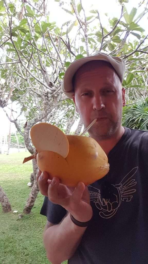Yours truly drinking a coconut
